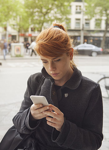 Girl watching a video on her smart phone