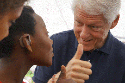 Photo of Bill Clinton using sign language