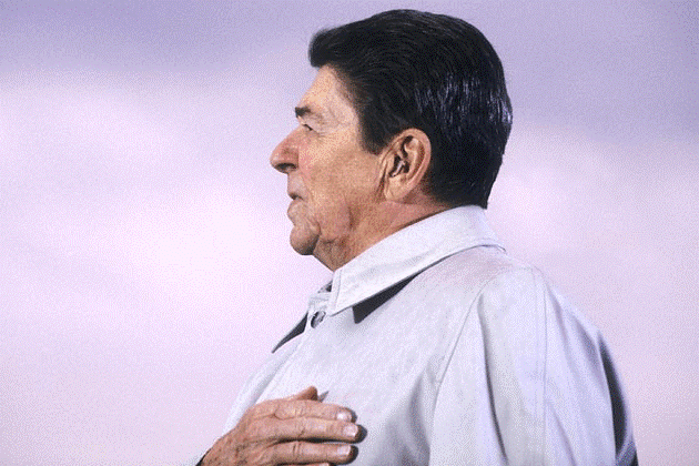 Photo of Ronald Reagan with a hearing aid
