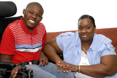 Boy in wheelchair and mother