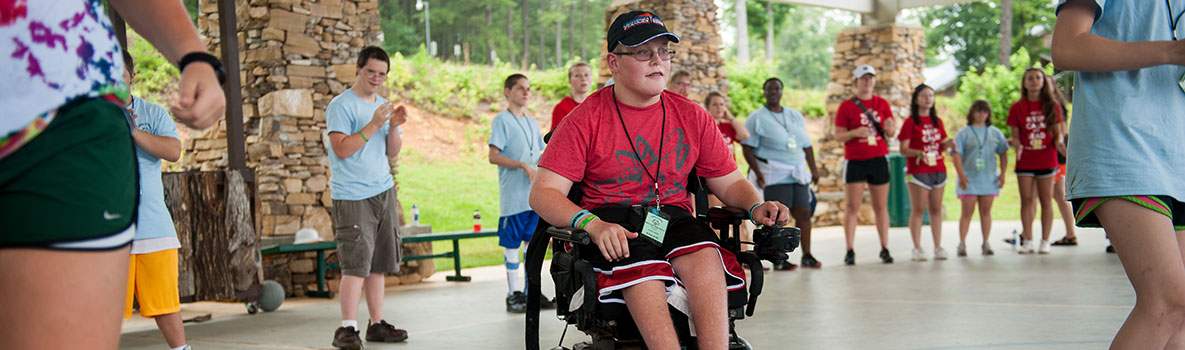 Boy in wheelchair doing activites with friends.
