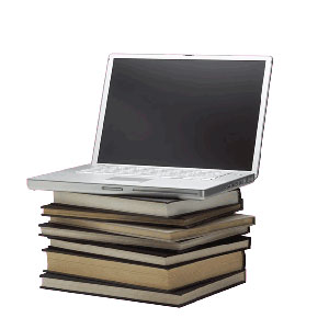 Laptop computer sitting on a stack of books