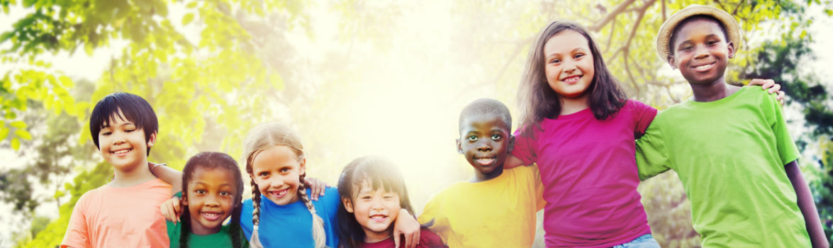 Photo of diverse children smiling
