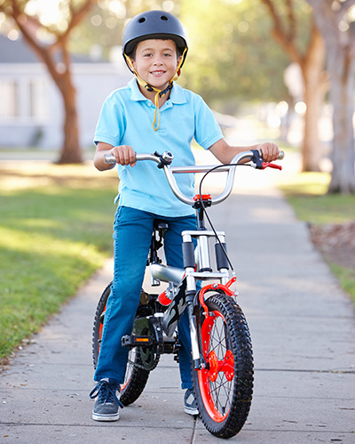 Boy sitting on a bike