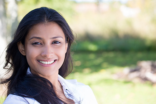 hispanic woman outside smiling