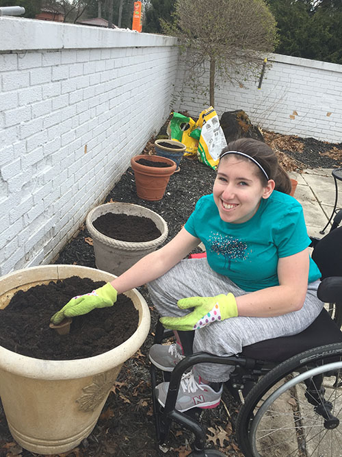 Woman with spina bifida gardening