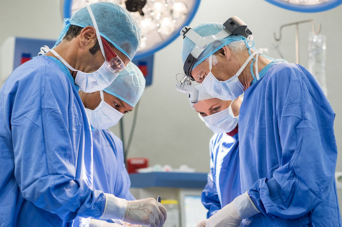 Team of surgeons operating