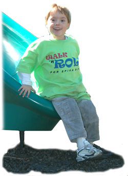 Boy with spina bifida on slide