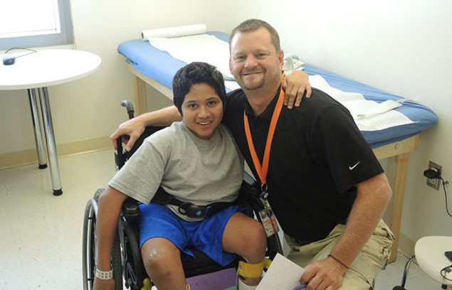 Photo: Boy with Physical Therapist