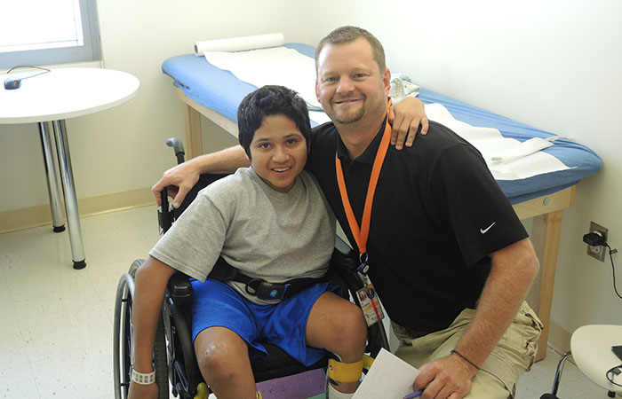 A boy with spina bifida and a health care provider