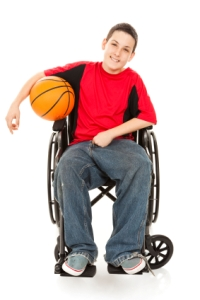Photo: Boy in a Wheelchair holding a basketball