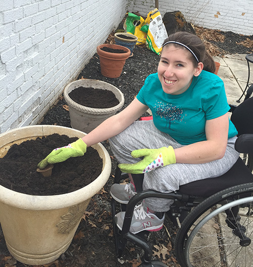Young woman gardening from her wheelchair
