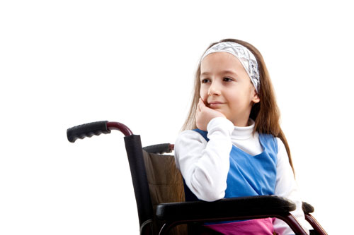 A young girl in a wheelchair