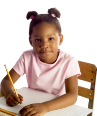 Photo: Girl sitting in a desk
