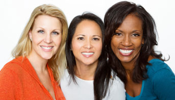 Three women smiling