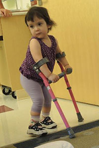 A toddler girl with spina bifida