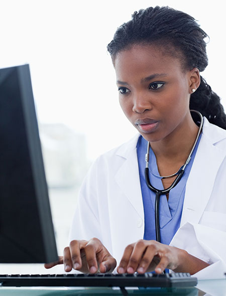 African-American woman doctor using a computer
