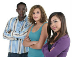 Three teens with there arms folded