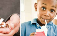 Broken cigarettes in a person's hands and an African-American boy drinking a milk box