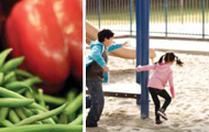 String beans with red bell pepper and a Caucasian boy and girl playing in a playground area