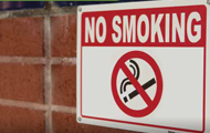 No Smoking sign on a brick building