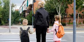 Mother about to cross road with son and daughter