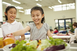 children getting healthy food in cafeteria