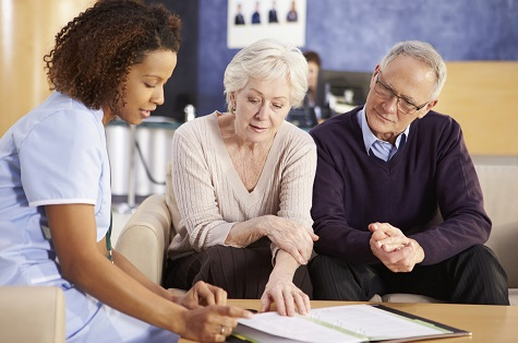 older couple talking with healthcare professional