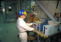 Technician Calibrating Air Monitoring Device