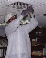 Man working on an airduct.
