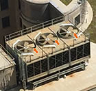 Photo shows arrows pointing to the fan blades on a cooling tower.