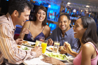Photo of 2 couples dining at a restaurant.