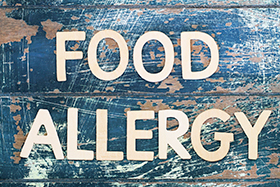 Photo of an old sign that reads Food Allergy.