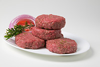 Photo beef patties on a plate.