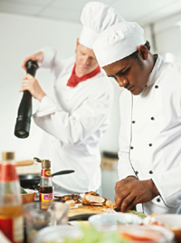 photo of chefs preparing food in a kitchen - Kitchen Manager