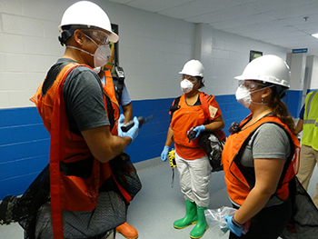 Students prepare to conduct an environmental health building assessment following a simulated disaster during the EHTER Operations course.