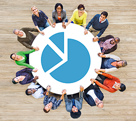 Photo of a people at a circular table with a graph in the middle.