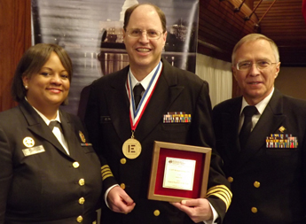 Gelting (center) is shown with US Surgeon General Regina M. Benjamin (left) and Sven E. Rodenbeck (RADM, USPHS) (right). Photo by Sue Gelting.