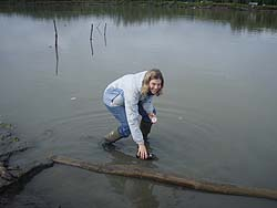 Nancy Fleischer, PhD (EIS '10) collecting a water sample in Alaska