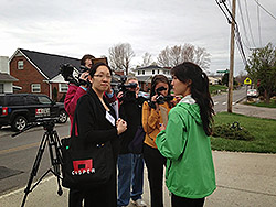 Joy Hsu, MD, (EIS '13) communicating with media during a field investigation of the public health effects of a chemical release in West Virginia