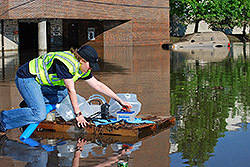 Ellen Yard, PhD (EIS '09) checking water quality during flood in Tennessee