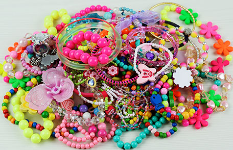 Pile of colorful plastic jewelry