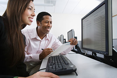 a%20male and female scientist looking at data on a computer