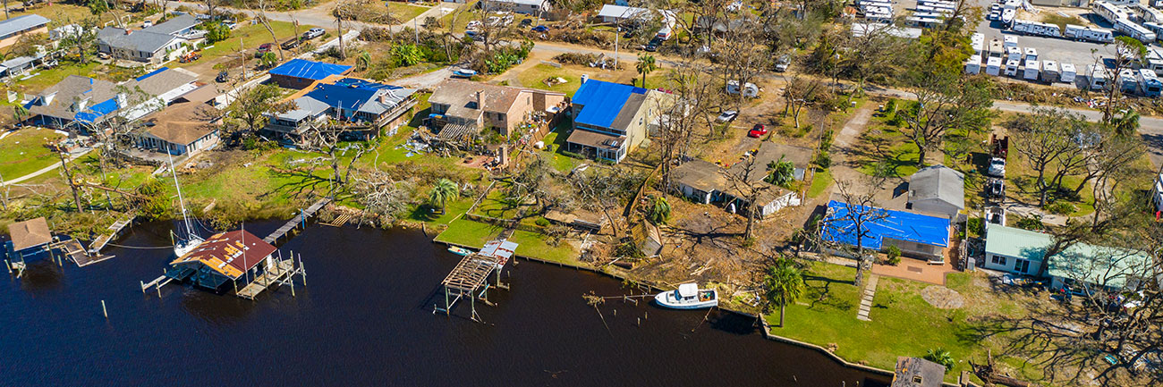 Aerial shot of a community recovering from structural damage after a natural disaster.