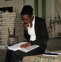 Epidemiologist Johnni Daniels reviews data from tests in a Kenya maize processing plant.