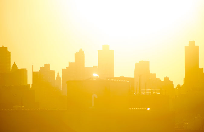 image of a city with the sun shining and extreme heat index