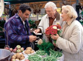 Senior couple shopping at a farmers market