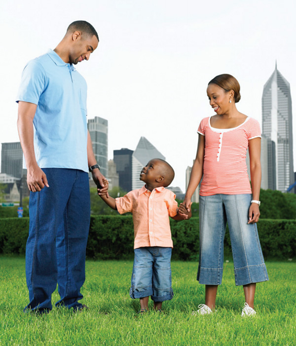 Family standing together in park