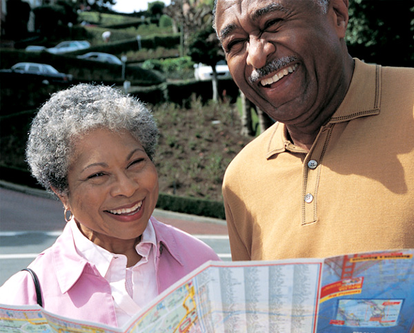 Senior couple looking at map while sightseeing.