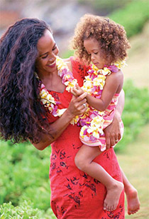 Mother in Hawaiian dress holding a child
